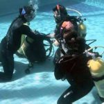 Dive Masters - Learning remove and replace scuba unit underwater skill