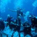 MSDT course in Cozumel. Students and Staff show off underwater in the Marine Park