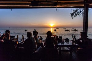 Island life style at Koh Tao in Thailand with friends at sunset. Relax with a Diving Instructor or Divemaster